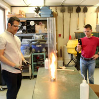 Engineering graduate student Ebrahim Feyz creates a fire tornado while Minority Engineering Advancement Program campers look on. Tim Brouk, IU Communications